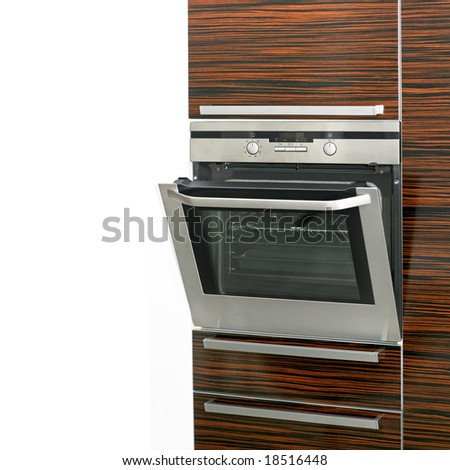 Close up shot of electric oven in cabinet - stock photo