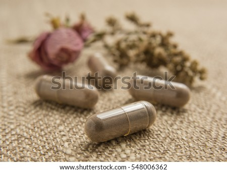 Close up shot of encapsulated placenta pills which can help during postpartum.