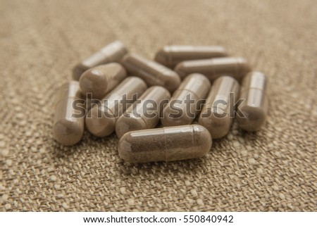 Close up shot of encapsulated placenta pills which help during postpartum.