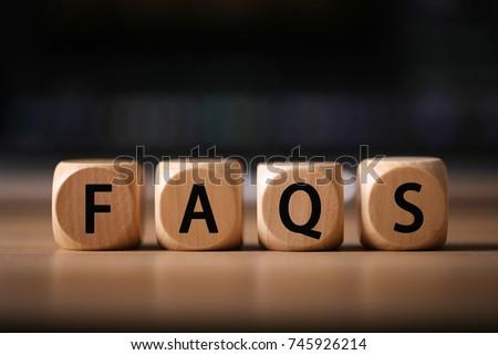 Close-up Shot of FAQS wooden blocks.