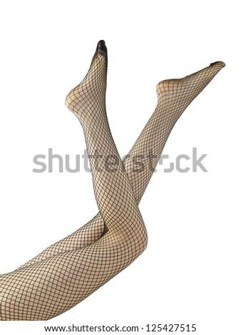 Close-up shot of female's leg wearing black net stockings