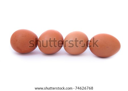 close up shot of four eggs on white background