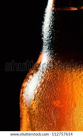 Close up shot of frosty beer bottle