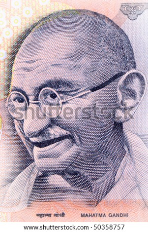 Close up shot of Gandhi on Indian rupee note