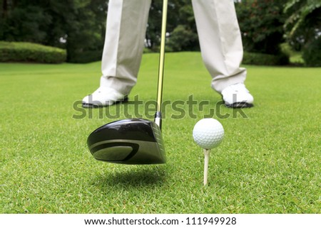 close up shot of golfer ready to tee off