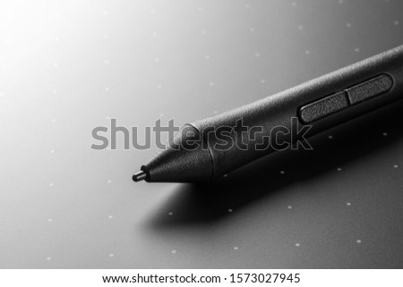Close up shot of Graphic tablet with pen for illustrators and designers. Graphic design instrument.