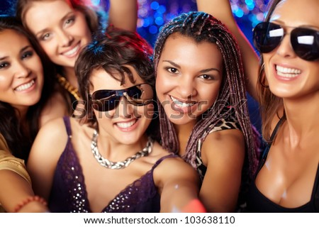Close-up shot of group of partying girls having fun