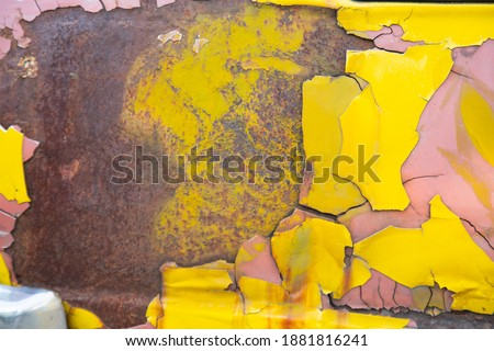 Close up shot of grunge and peeling off paint yellow retro sport car which is abandoned in the street shows colorful colors (yellow, red and orange) and beautiful textured surface for backgrounding Сток-фото ©