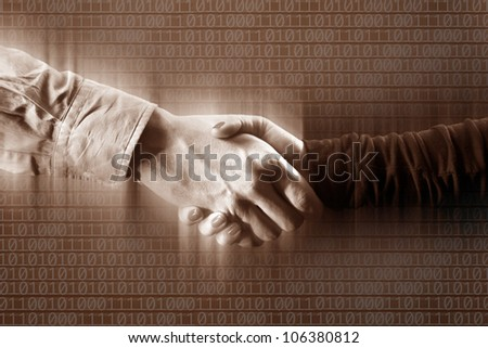 close up shot of handshake of a woman and a man - stock photo