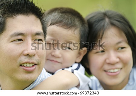 close up shot of happy asian family on outdoor