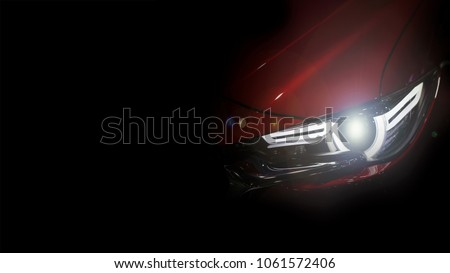 Close up shot of headlight in luxury  red car background with copy space. Modern and expensive sport car concept