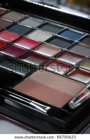 Close up shot of Makeup set. Selection of cosmetic colors.  Taken in vertical format.