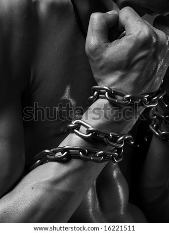Close-up shot of male hand wound by chain