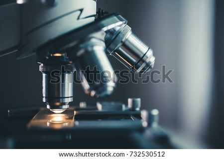 Close-up shot of microscope with metal lens at laboratory. #732530512