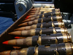 Close up shot of 7.62mm ammunition with red tracer tips