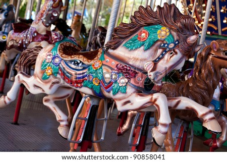 Close up shot of one of the horses in a merry-go-round theme park.