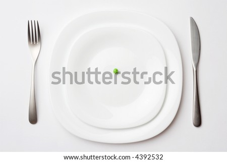 close-up shot of place setting with pea