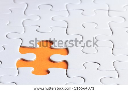 close up shot of plain puzzle with a missing piece