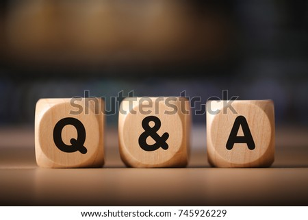 Close-up Shot of Q and A wooden blocks.