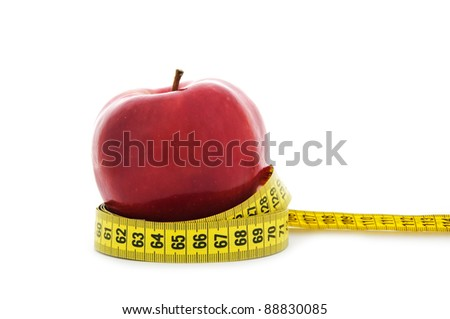 close up shot of red apple with yellow measuring tape isolated on white background - nutrition, healthcare and diet concept