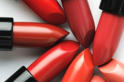 close-up shot of red lipsticks of different shades on white tabletop