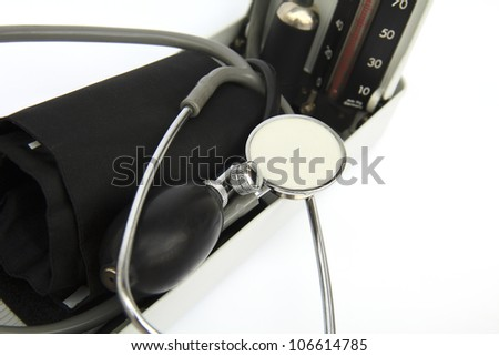 close up shot of retro sphygmomanometer and stethoscope