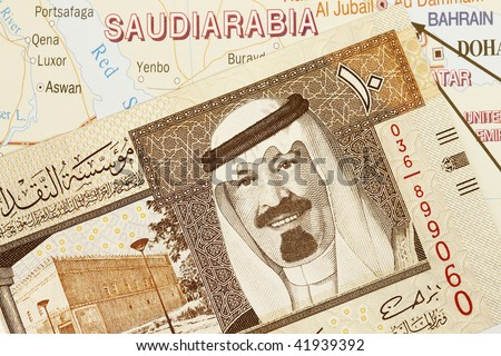 Close up shot of Saudi Arabia money and map.