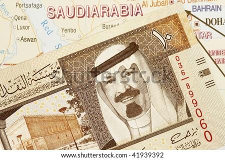 Close up shot of Saudi Arabia money and map.