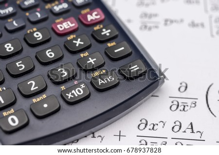 Close up shot of scientific calculator and mathematical equations sheets