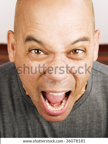 Close up shot of screaming man\'s face