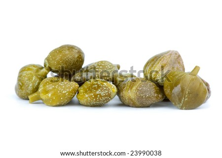 Close-up shot of some marinated capers isolated on the white background