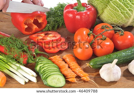 close-up shot of someone cutting up colorful different vegetables