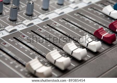 close up shot of sound mixer in studio  - shallow DOF