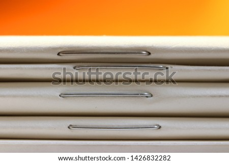 Close up shot of stack of thin books Photo stock ©