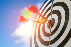 Close up shot of the dart arrow hit on bullseye, red dart arrow hitting in the target center of dartboard Target hit in the center, challenge in business marketing,Target and goal as concept.