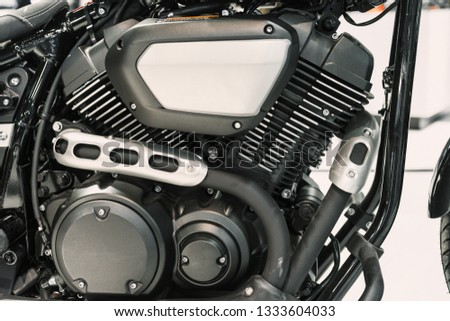 Close up shot of the engine of a black motorcycle in the side view. #1333604033
