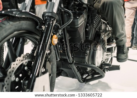 Close up shot of the engine of a black motorcycle in the side view. #1333605722