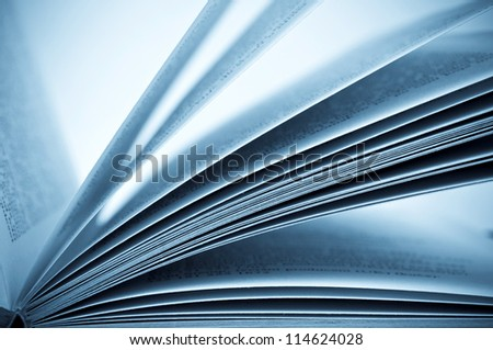 Close-up shot of the open book - blue toned image