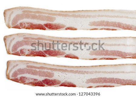 Close-up shot of three sliced bacon isolated on white background.