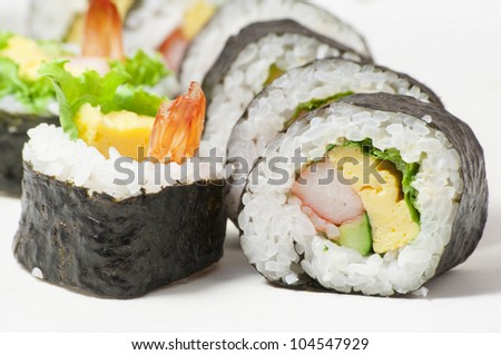 close-up shot of traditional fresh japanese sushi rolls, focus on the front piece