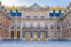 Close up shot of Versailles Palace during the day. High dynamic range in the sky. No people in the foreground. Shot in France