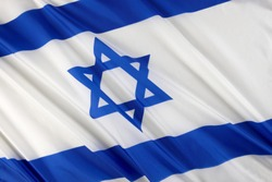 Close up shot of wavy blue and white Israeli flag