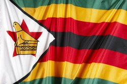 Close up shot of wavy flag of Zimbabwe