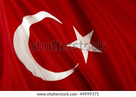 Close up shot of wavy, shiny Turkish flag