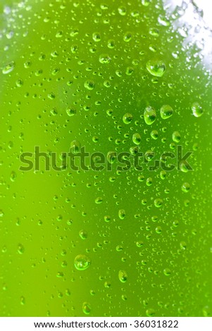 Close up shot of wet bottle with tropical drink