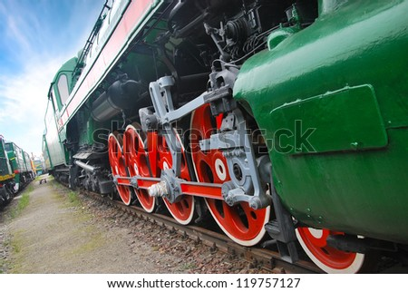 Close up shot of wheels of the old locomotive