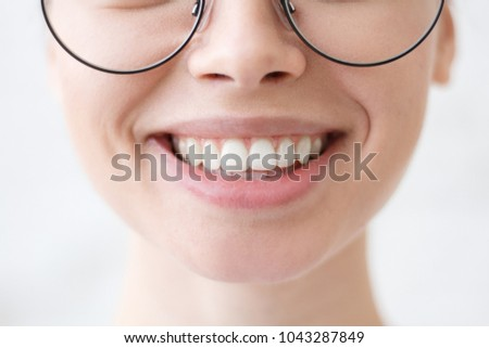 Close up shot of young beautiful woman toothy smile
