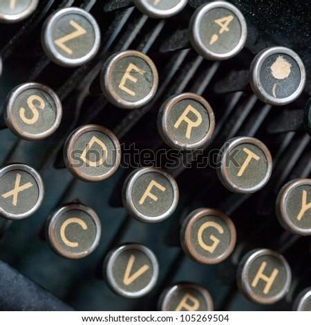 Close up shot on vintage typewriting machine keys