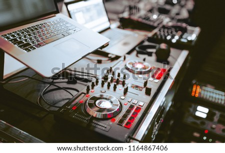 Close up shot vintage vinyl party dj audio equipment.Turntable High quality Sound mixing controller disc jockey in night club  . Pro audio equipment on stage in nightclub. Hifi sound system .