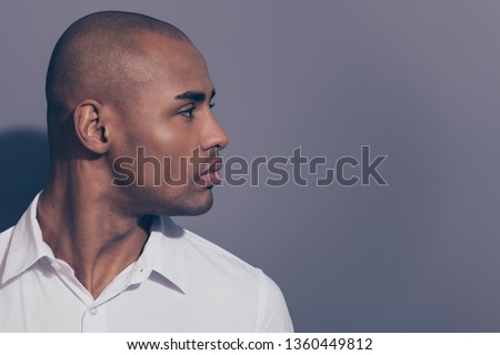 Close up side profile photo amazing dark skin he him his macho perfect head hairdo condition look empty space not smiling wondered listen news wear white shirt isolated grey background